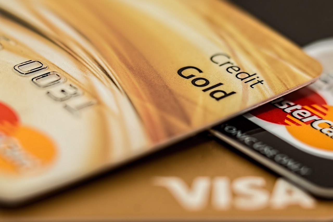 Open a bank account and apply for secured credit card