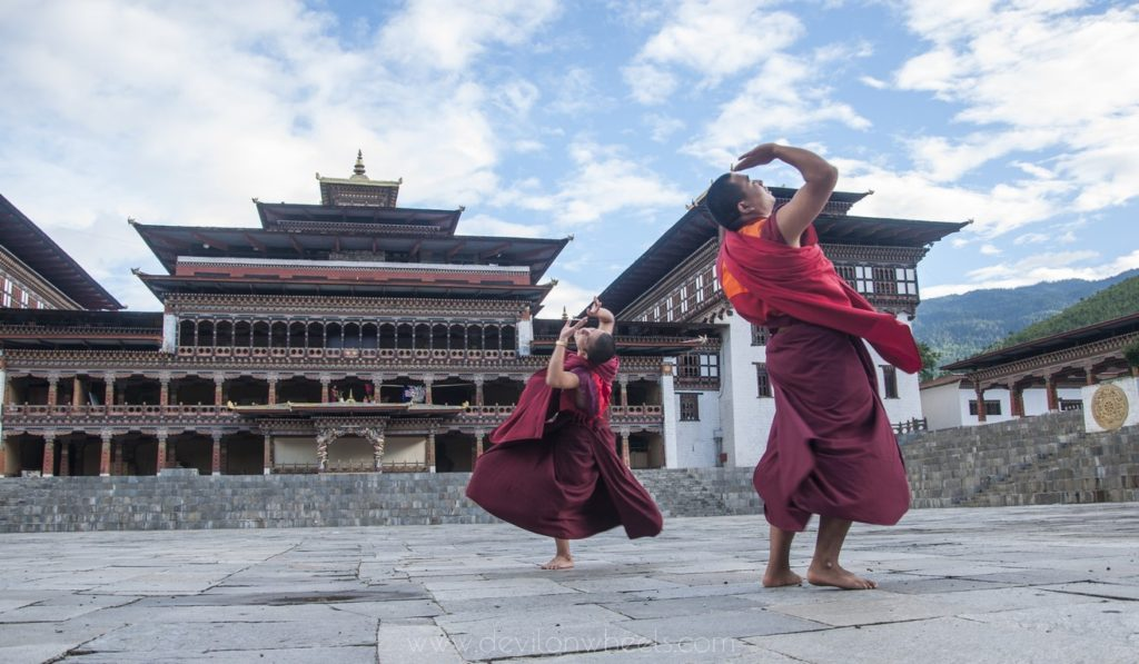 Dancing to the beats of Dragon in a monastery in Bhutan