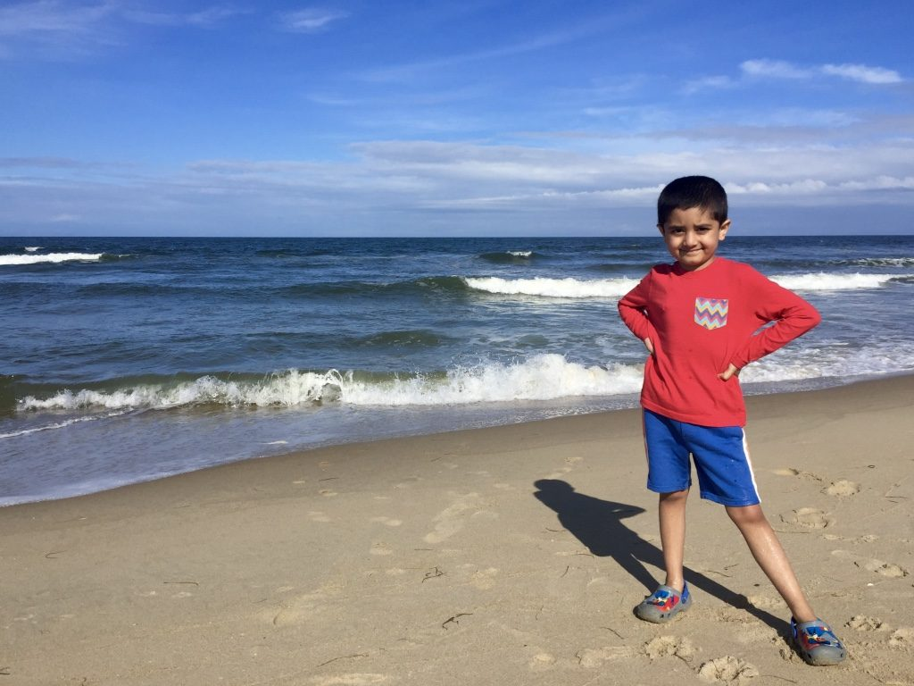 Kiddo excited being first time at the beach
