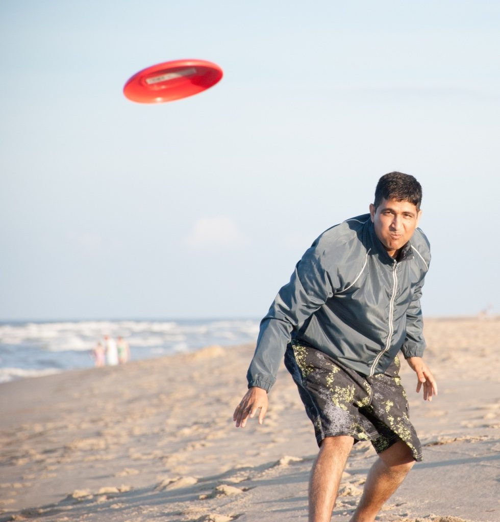 It's Frisbee Playtime at the Beach - Nags Head