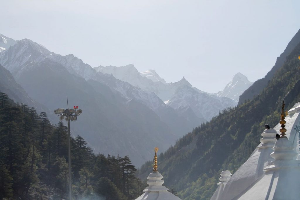 The Gangotri Dham set amidst the snow peaks which one can see at the start of trek
