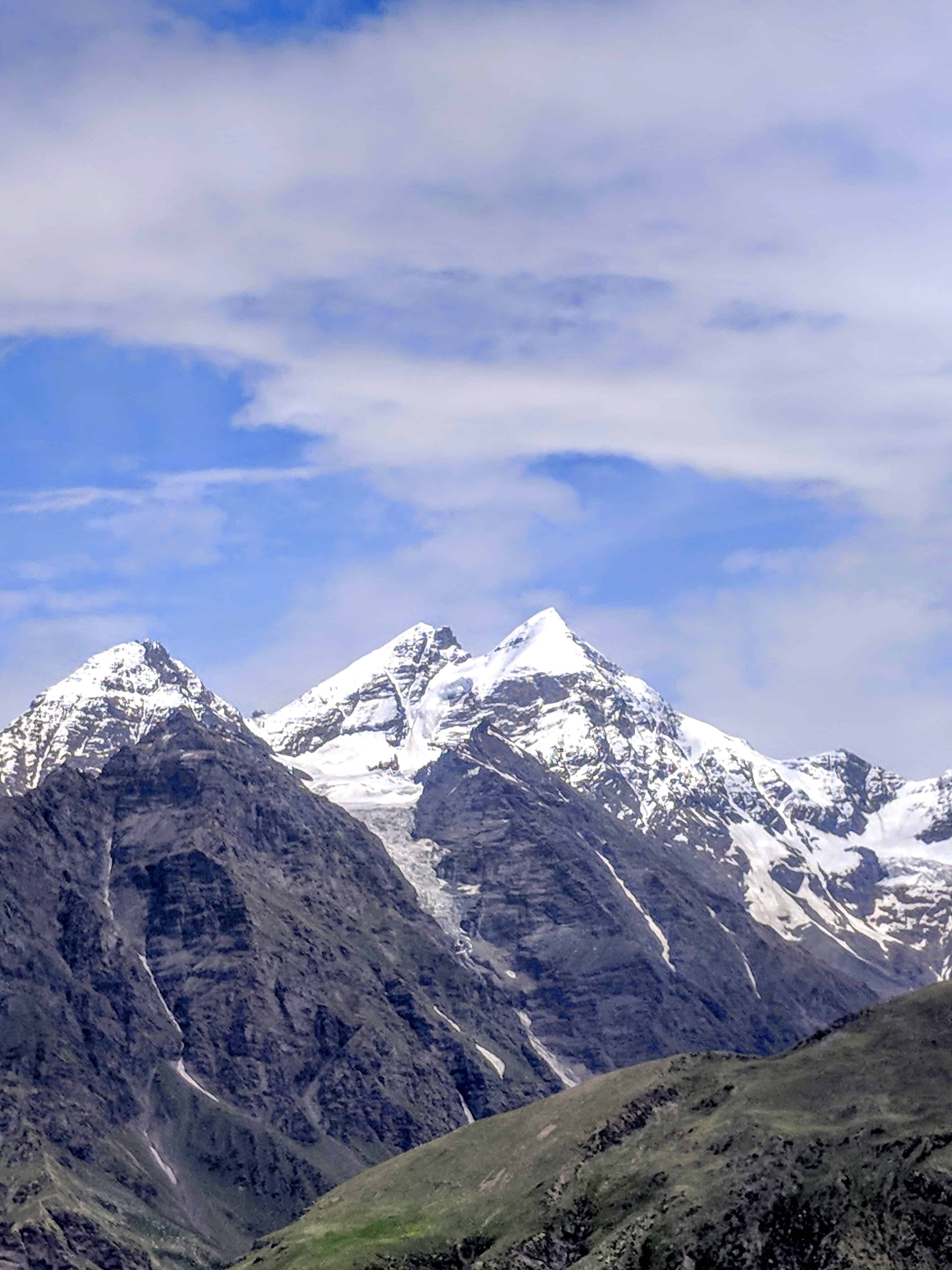 Enticing us to keep moving forward, the snow-capped mountains around Rohtang-La