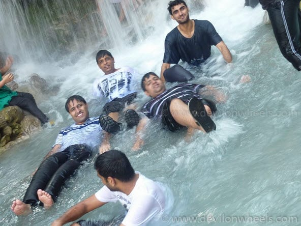 Getting Wet in Waterfall with Friends