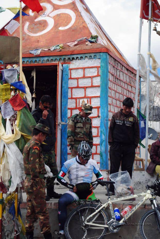 One leg men on bicycle at Khardung La top in Leh - Ladakh