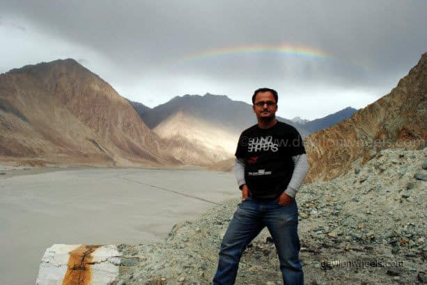 Dheeraj Sharma with rainbow on the road to Nubra Valley from Khardung La in Leh - Ladakh