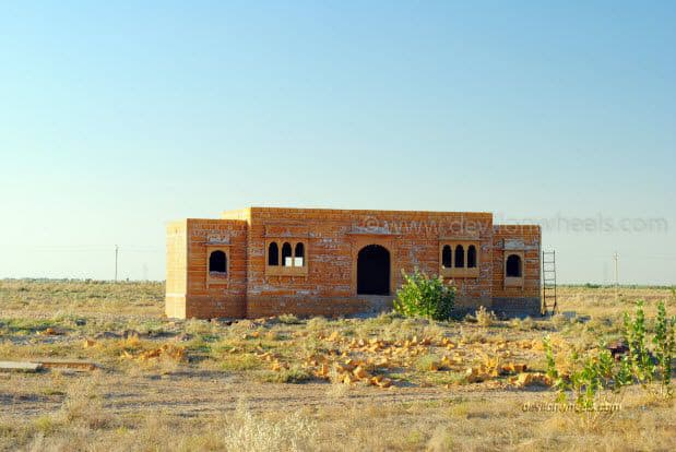 An empty house on a road from Bikaner to Jaiselmer