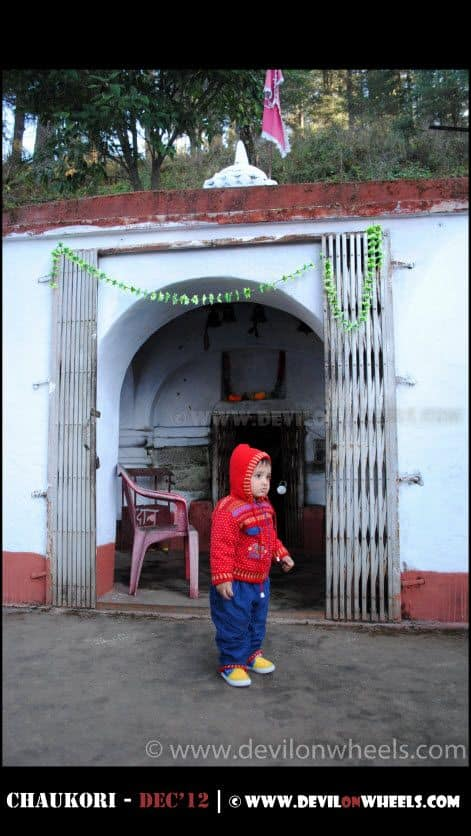 Junior standing at the entrance of Patal Bhuwaneshwar Cave