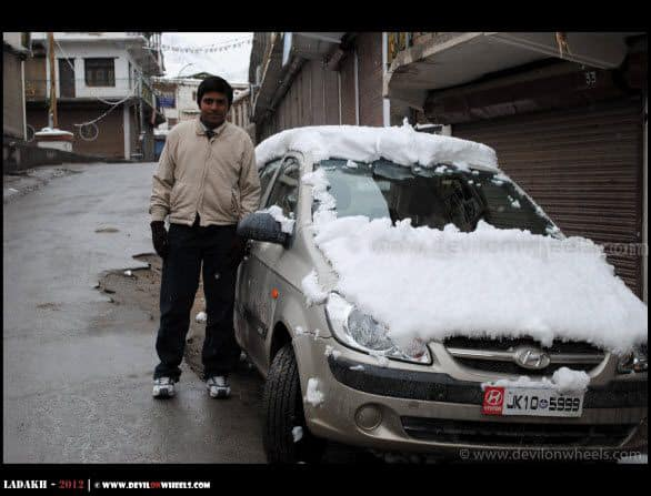 Snow Sheets Over Cars in Leh