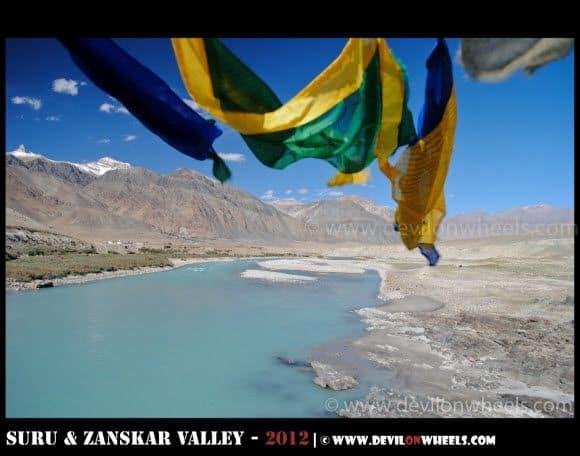 Aqua Colored Zanskar River with Prayer Flags in Zanskar Valley
