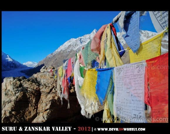 Prayer Flags and Drang Drung Glacier in the background