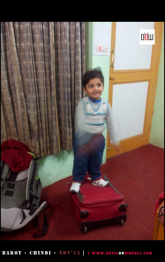 Junior playing in room in Barot