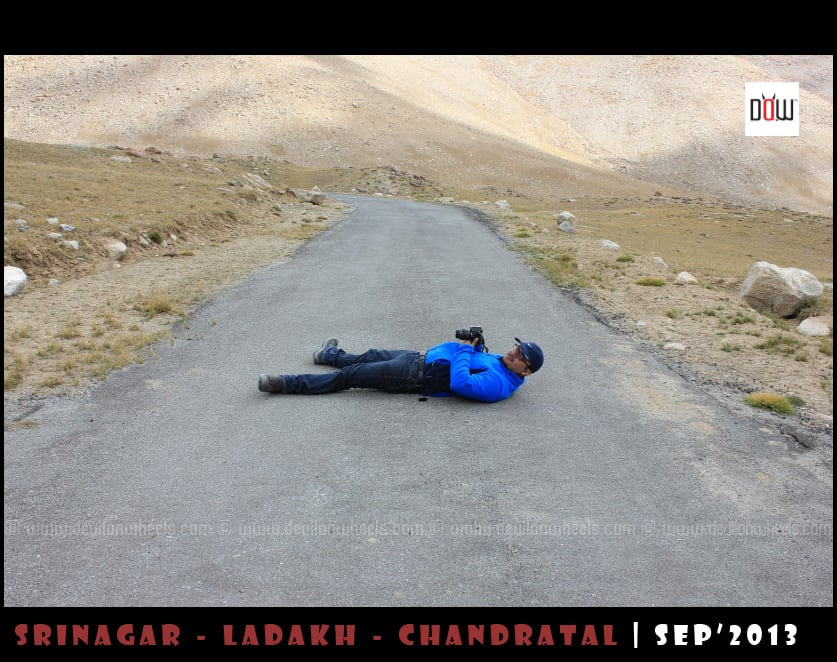 Dheeraj lying on road to Wari La Pss