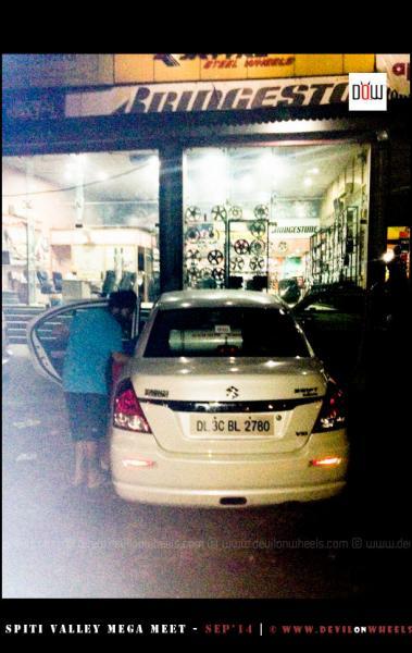 Car's wheel rim getting replaced in Ambala on the way to Fagu