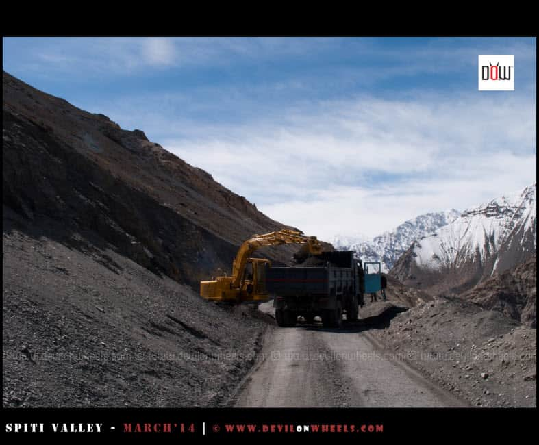 Bulldozer clearing a mud slide